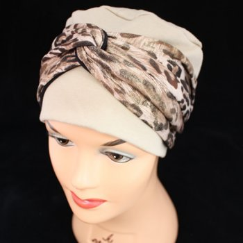 Elegant Tan Turban Hat With A Metallic Leopard Print Twist Wrap