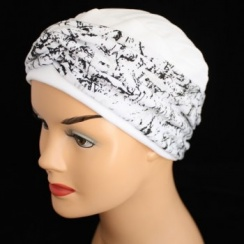 Elegant White Hat With A Black And Silver Twist Wrap